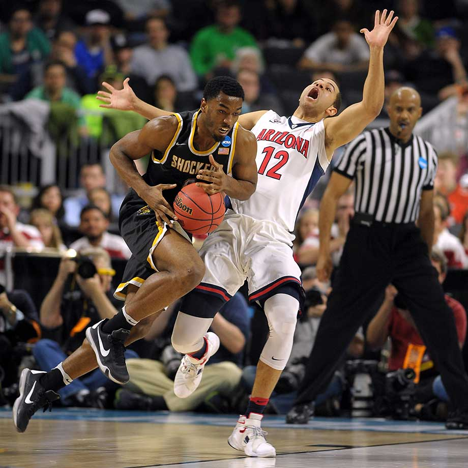 Rashard Kelly of Wichita State drives against Ryan Anderson of the Arizona Wildcats.