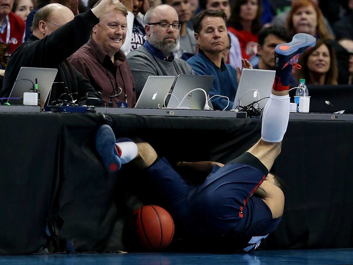 Josh Perkins of the Gonzaga Bulldogs almost slides completely under a table during a win over Seton Hall.