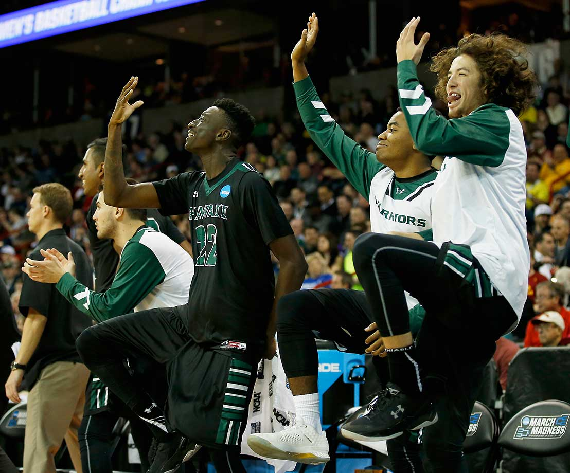 The Hawaii Warriors bench celebrates in the closing minutes against Cal.