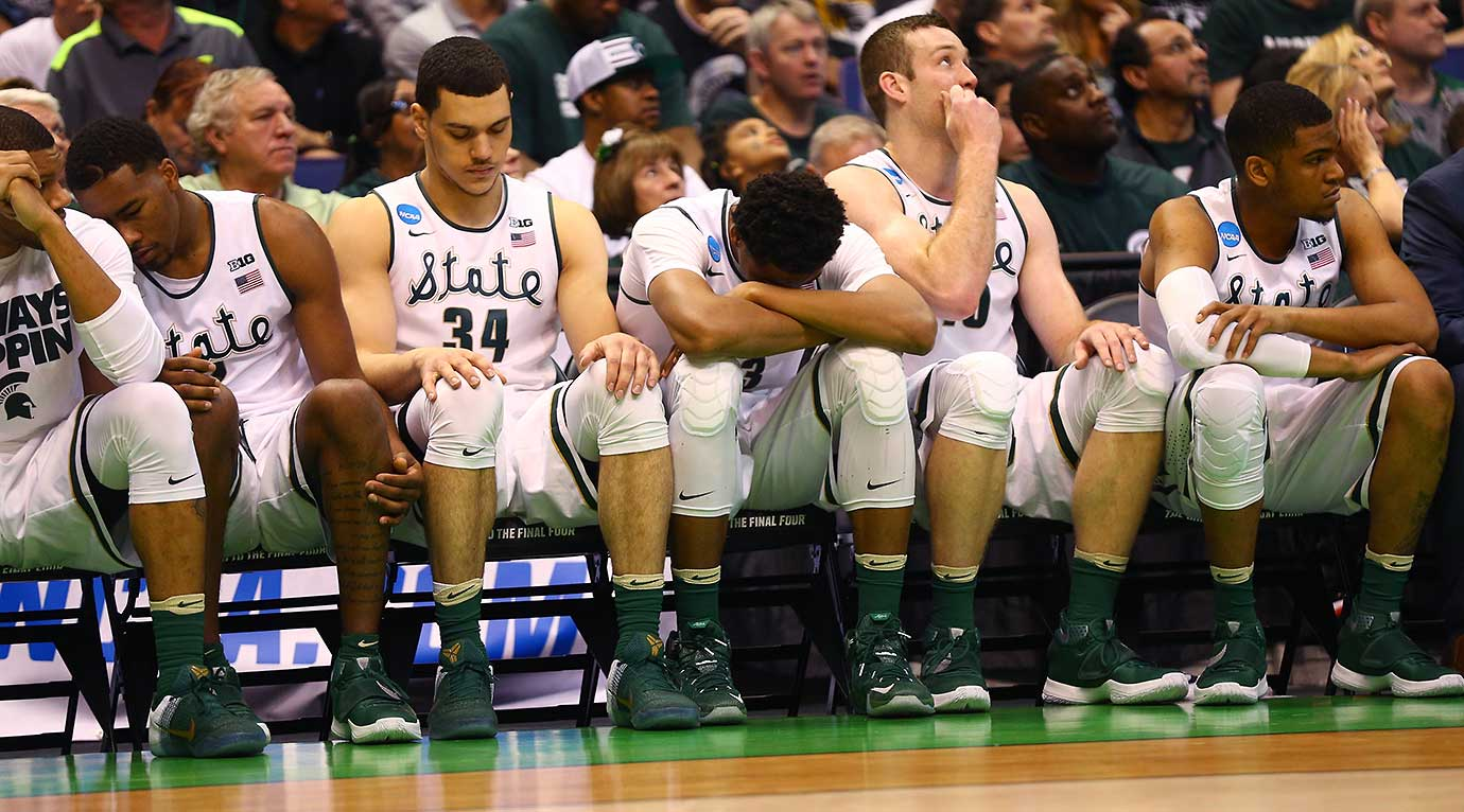 The Michigan State Spartans bench looks on late in the loss to a 15th seed, the Middle Tennessee Blue Raiders.