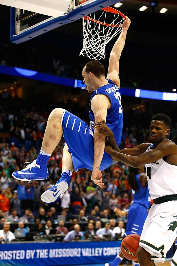 Reggie Upshaw of the Middle Tennessee Blue Raiders dunks late in the win over No. 2 seed Michigan State.