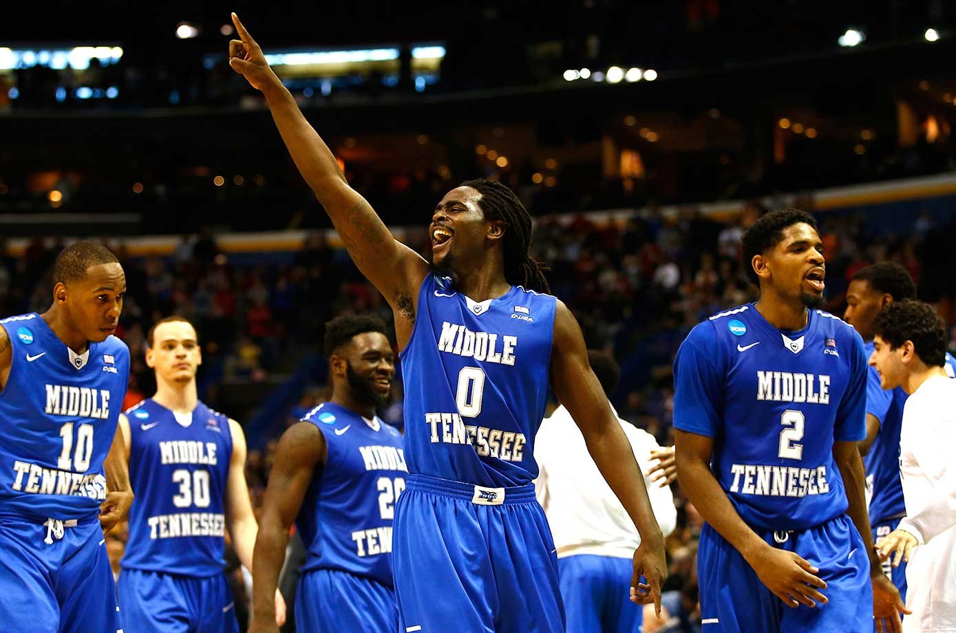 Middle Tennessee State players celebrate after pulling off one of the biggest upsets in tournament history.