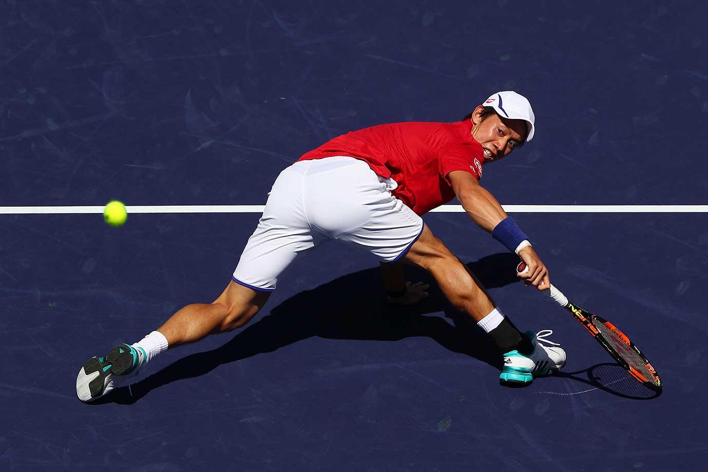 Kei Nishikori of Japan in action in his match against Rafael Nadal of Spain.