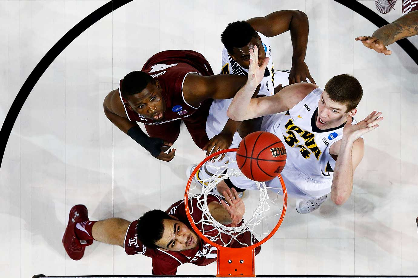 Adam Woodbury of the Iowa Hawkeyes shoots the game-winning basket in overtime to defeat the Temple Owls.