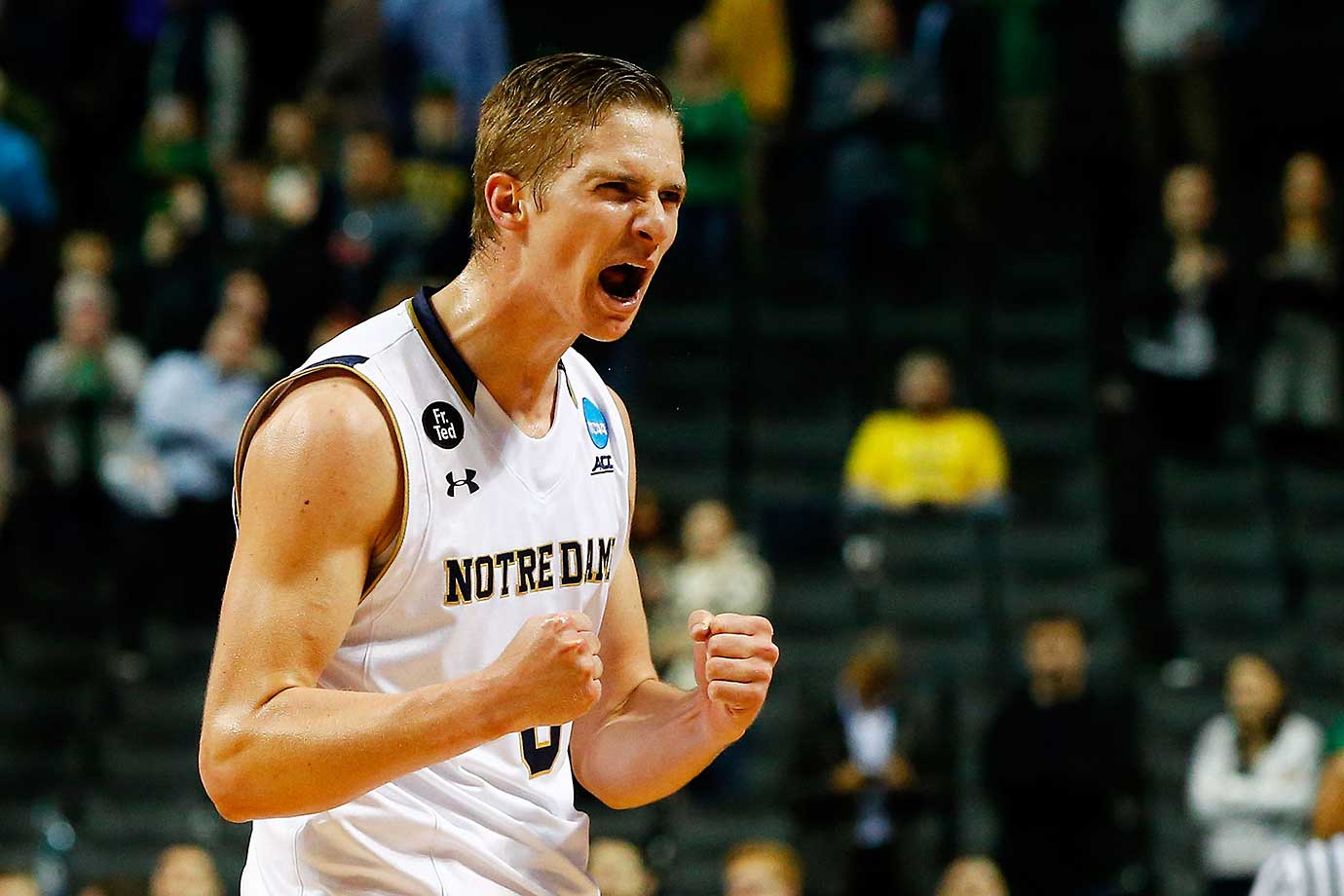Rex Pflueger of the Notre Dame Fighting Irish celebrates a 70-63 win over the Michigan Wolverines.