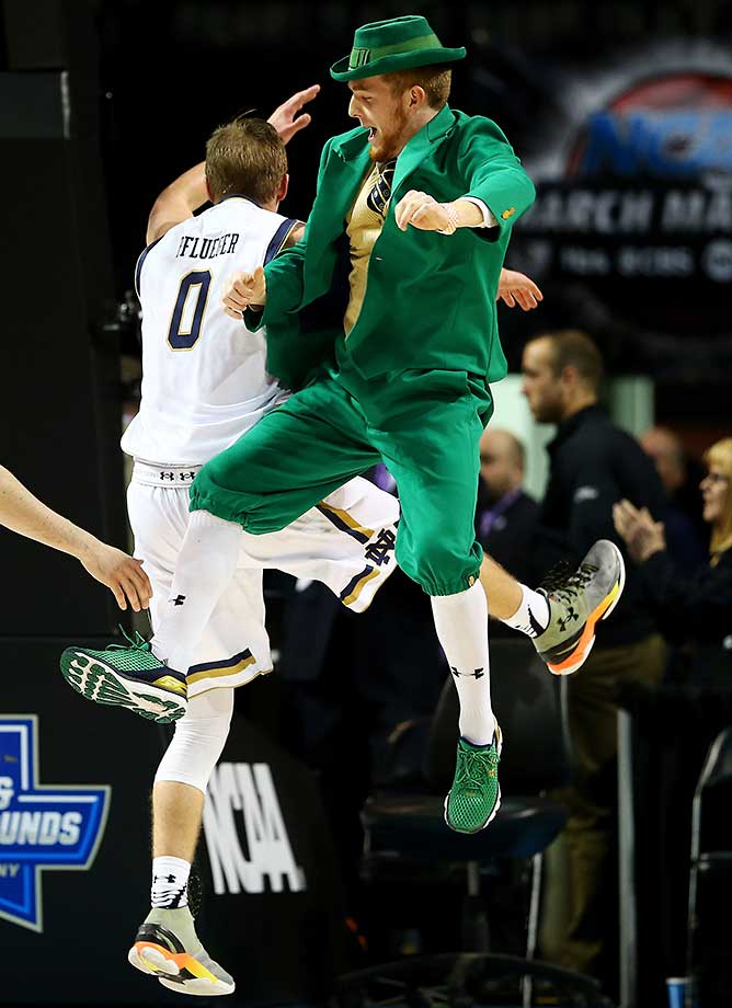 Rex Pflueger and the Fighting Irish mascot after a 70-63 win over Michigan at Barclays Center in Brooklyn.