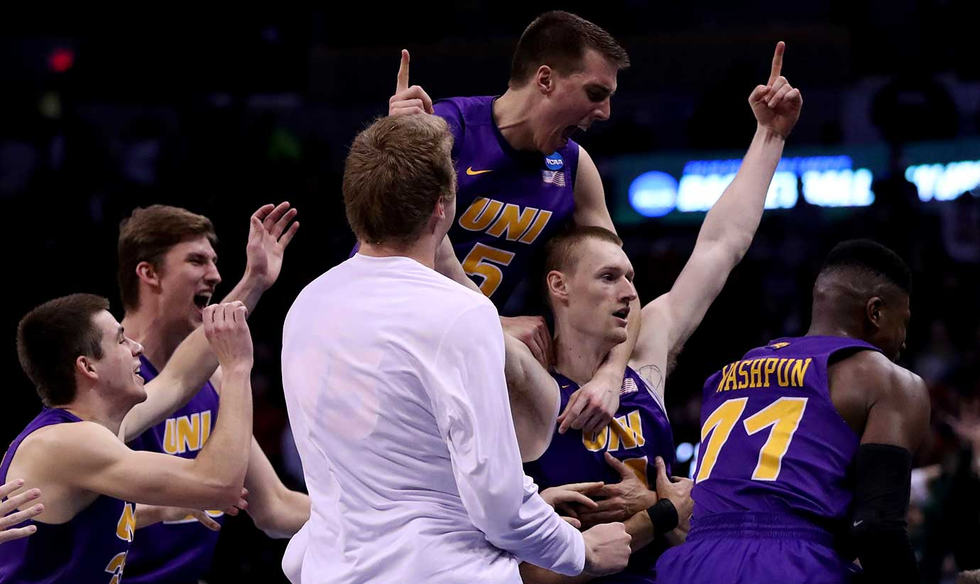 The Northern Iowa Panthers mob Paul Jesperson (4) after his dramatic game winner at the buzzer against Texas.