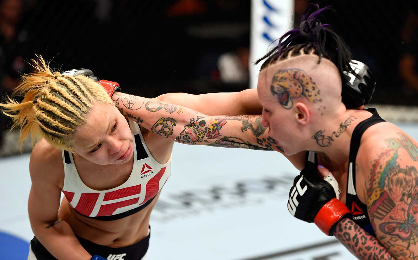 Seohee Ham of South Korea and Bec Rawlings of Australia exchange punches in their strawweight bout during the UFC Fight Night in Brisbane, Australia.