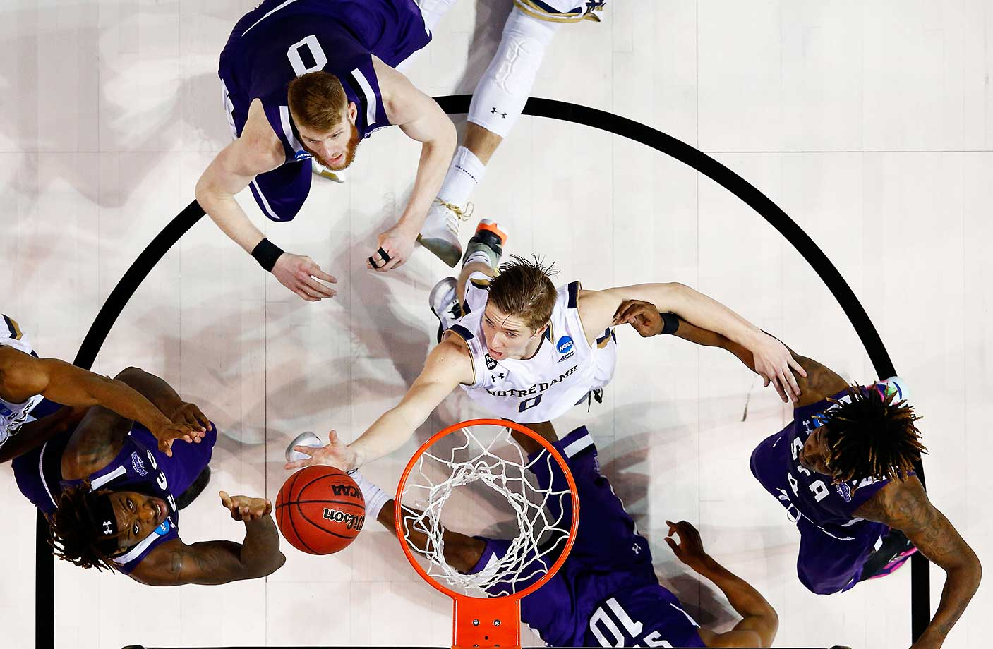 Rex Pflueger of Notre Dame tips in a shot with 1.5 seconds remaining to defeat Stephen F. Austin 76-75.
