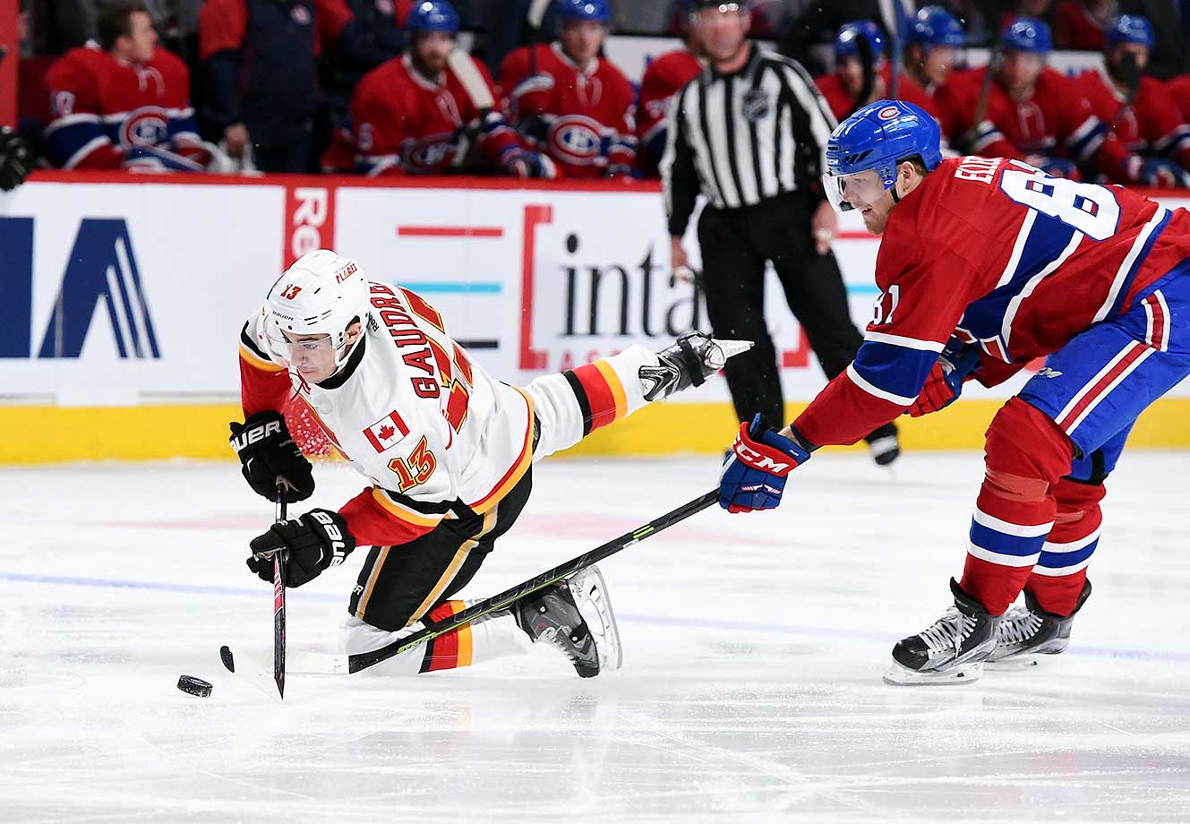 Johnny Gaudreau of the Calgary Flames tries to keep the puck from Lars Eller of the Montreal Canadiens.