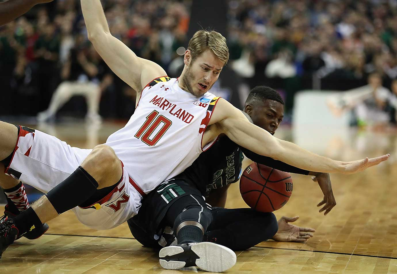 Michael Thomas of Hawaii battles for possession against Jake Layman of the Maryland Terrapins.