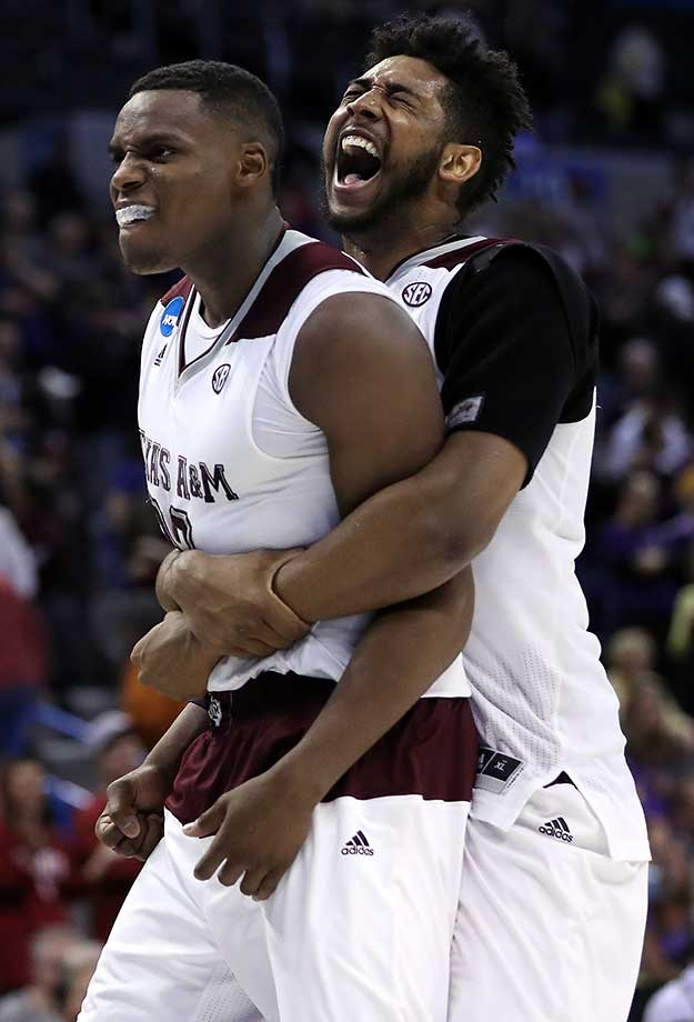Danuel House (23) celebrates with Tonny Trocha-Morelos after their double overtime win put them in the Sweet 16.