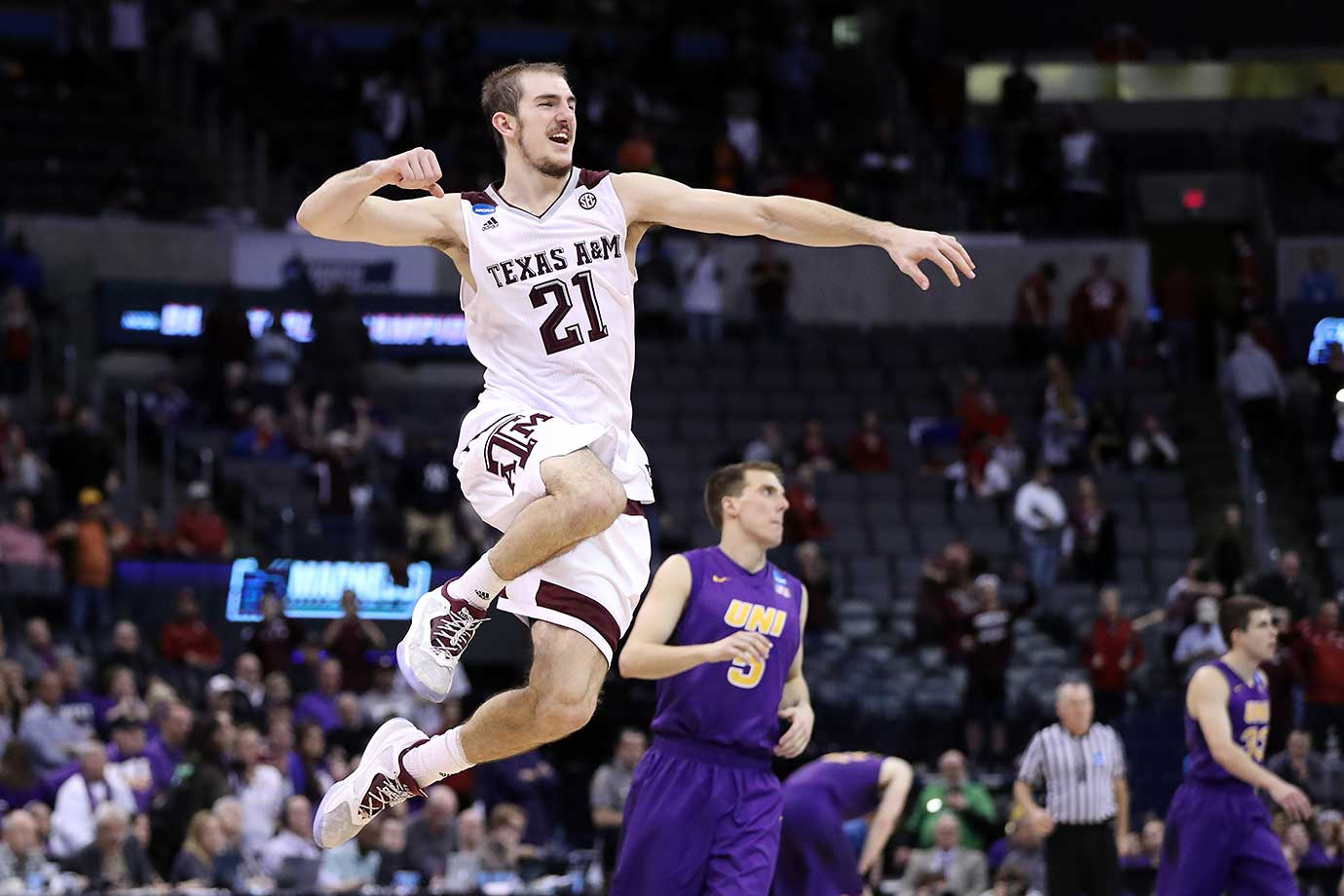 Here are some of the images that caught our eye on a day in which Texas A&M stole the show by overcoming an 12-point deficit in the final 34 seconds of regulation against Northern Iowa and winning in double overtime. Alex Caruso is shown here celebrating the 92-88 victory.