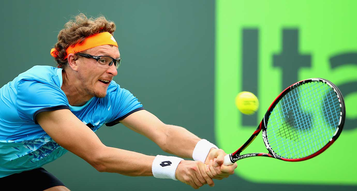 Denis Istomin of Uzbekistan plays a backhand against during Day 4 of the Miami Open in Key Biscayne, Fla.