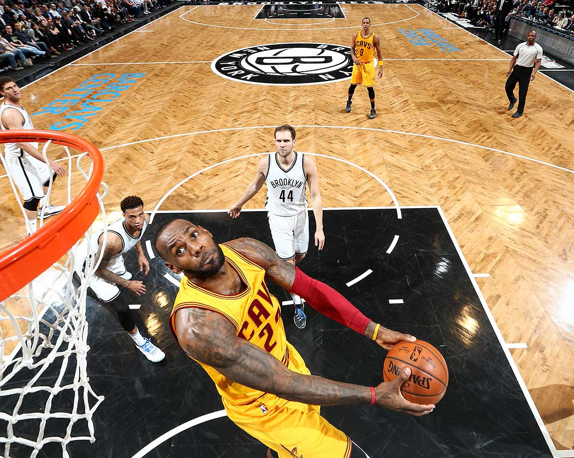 LeBron James goes for the dunk against the Brooklyn Nets during a game at Barclays Center in Brooklyn, New York.
