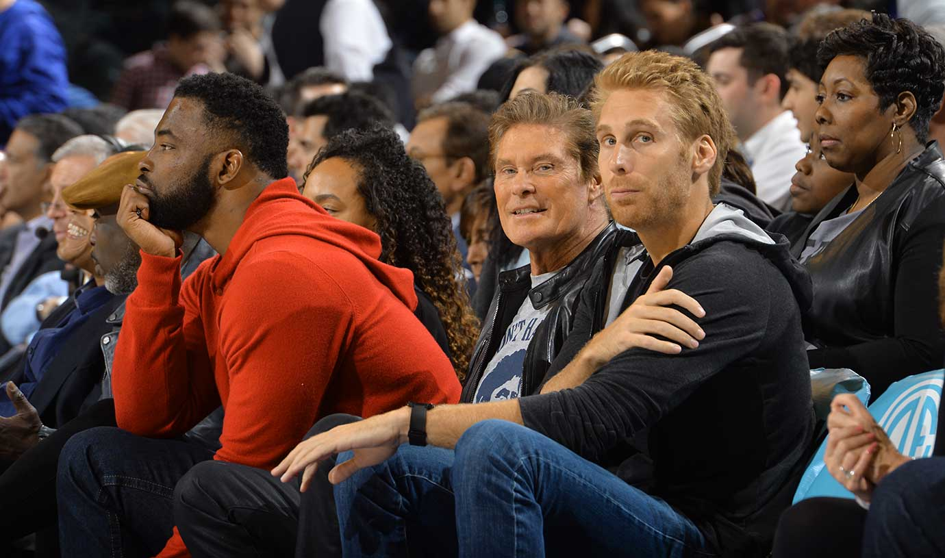 Former NFL defensive end Justin Tuck and actor David Hasselhoff look on during the New York Knicks game against the Chicago Bulls.