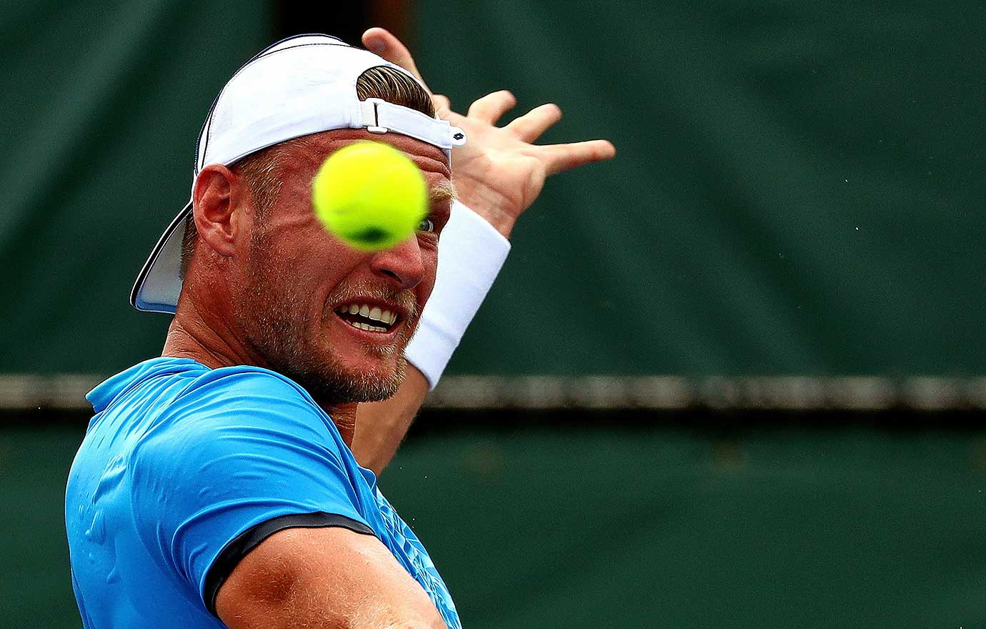 Sam Groth of Australia plays a match against Dominic Thiem of Austria during Day 5 of the Miami Open in Key Biscayne, Fla.