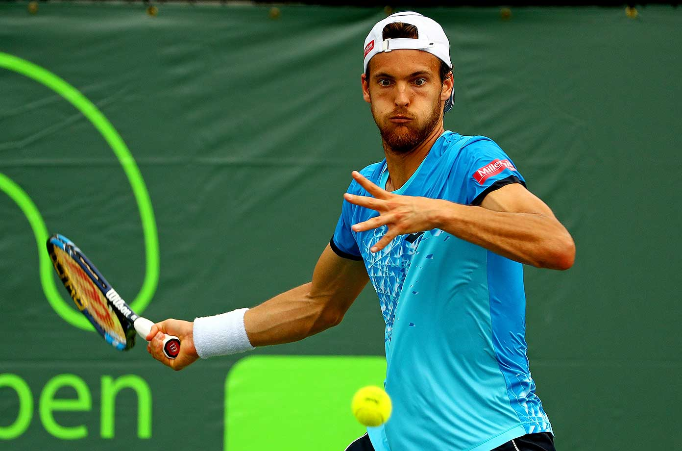 Joao Sousa of Portugal plays a match during Day 5 of the Miami Open in Key Biscayne, Fla.