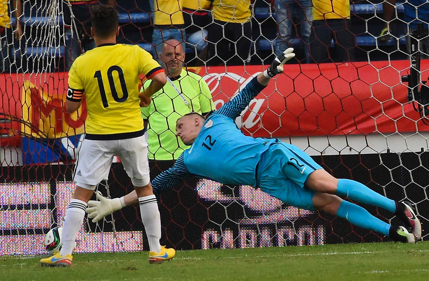 Colombia's Juan Fernando Quintero scores a penalty past USA's goalkeeper Coddy Crooper during their Rio 2016 Olympic qualifier match.