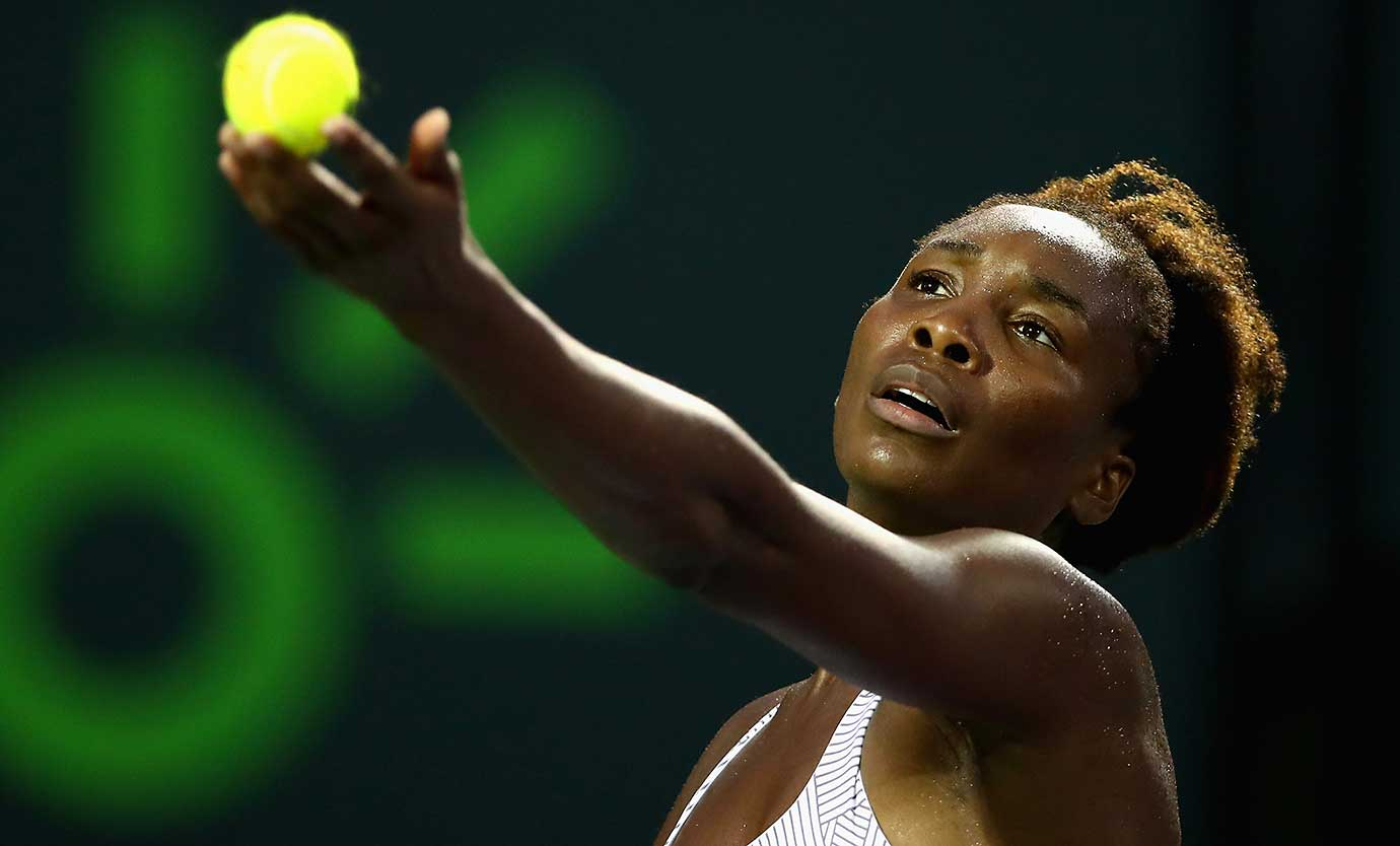 Venus Williams serves against Elena Vesnina of Russia in their second round match during the Miami Open.