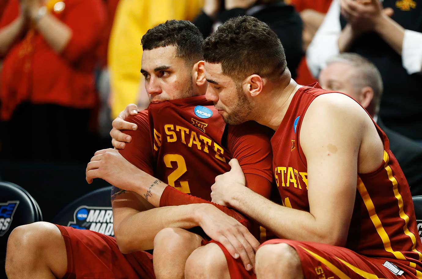 Georges Niang comforts Abdel Nader after Iowa State saw its season end with a dominating win by Virginia.