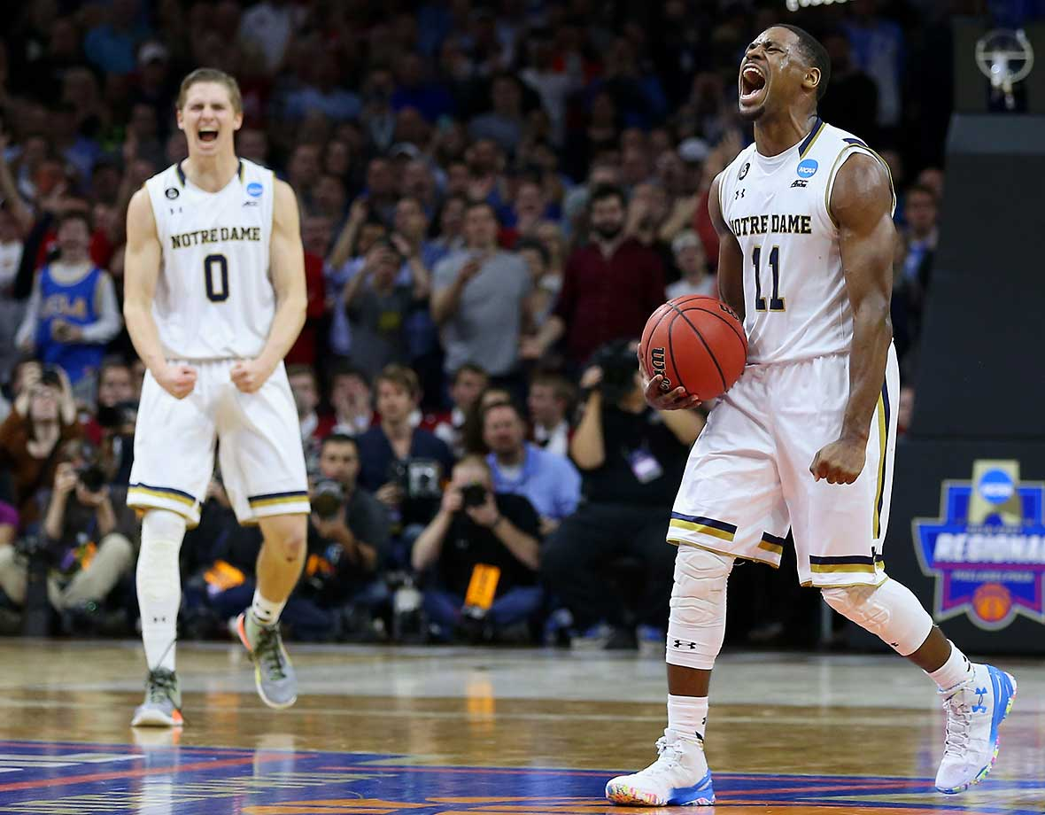 Here are some of the images that caught our eye on a busy Friday in which Notre Dame, North Carolina, Syracuse and Virginia advanced to the Elite Eight of the NCAA Tournament. Demetrius Jackson (11) and the Irish made it to a regional final for the second straight year by outscoring Wisconsin 8-0 down the stretch.