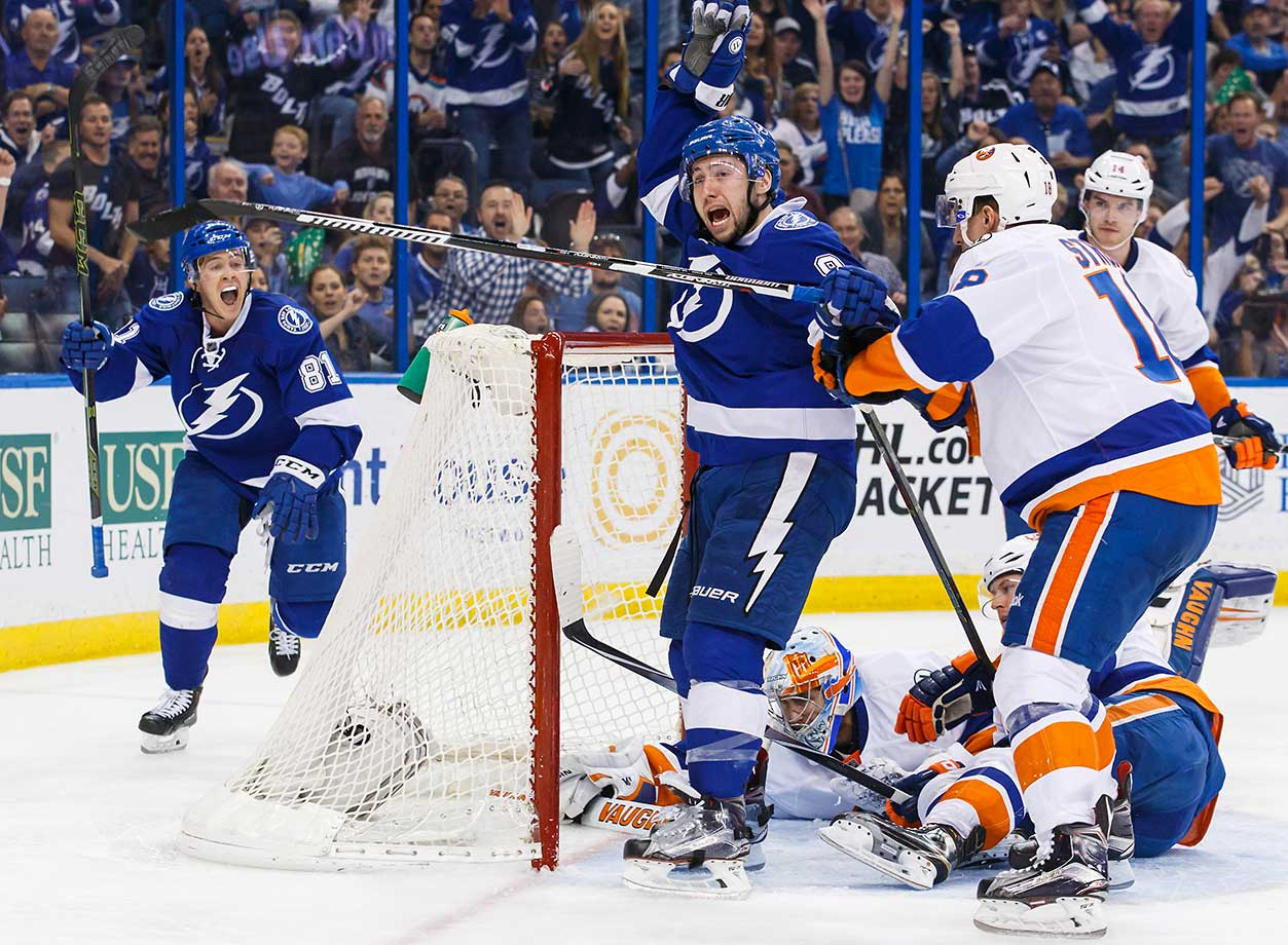 Jonathan Marchessault of Tampa Bay celebrates the goal by teammate Tyler Johnson (9) against goalie Thomas Greiss of the New York Islanders.