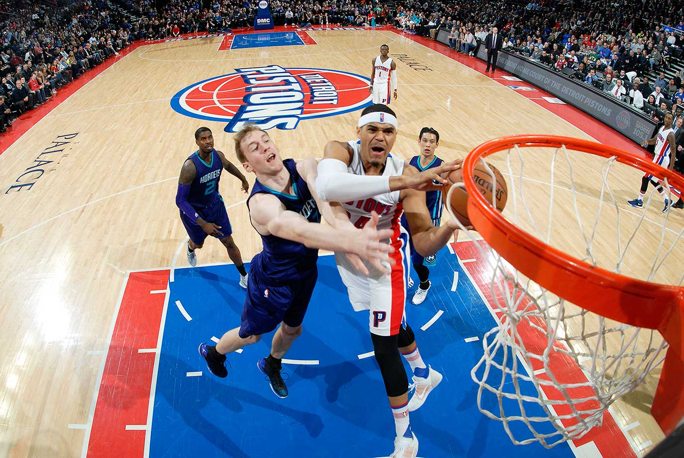 Tobias Harris of the Detroit Pistons shoots the ball against Cody Zeller of the Charlotte Hornets.