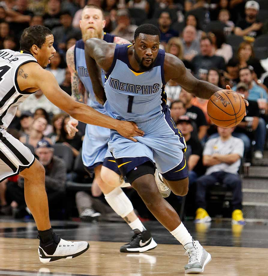Lance Stephenson of the Memphis Grizzlies is fouled by Andre Miller of the San Antonio Spurs.