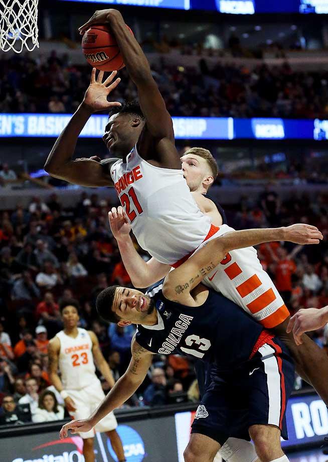 Tyler Roberson of Syracuse falls over Josh Perkins of Gonzaga.