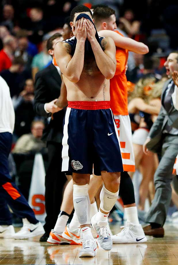 Josh Perkins of the Gonzaga Bulldogs reacts as the Syracuse Orange celebrate their 63-60 victory.