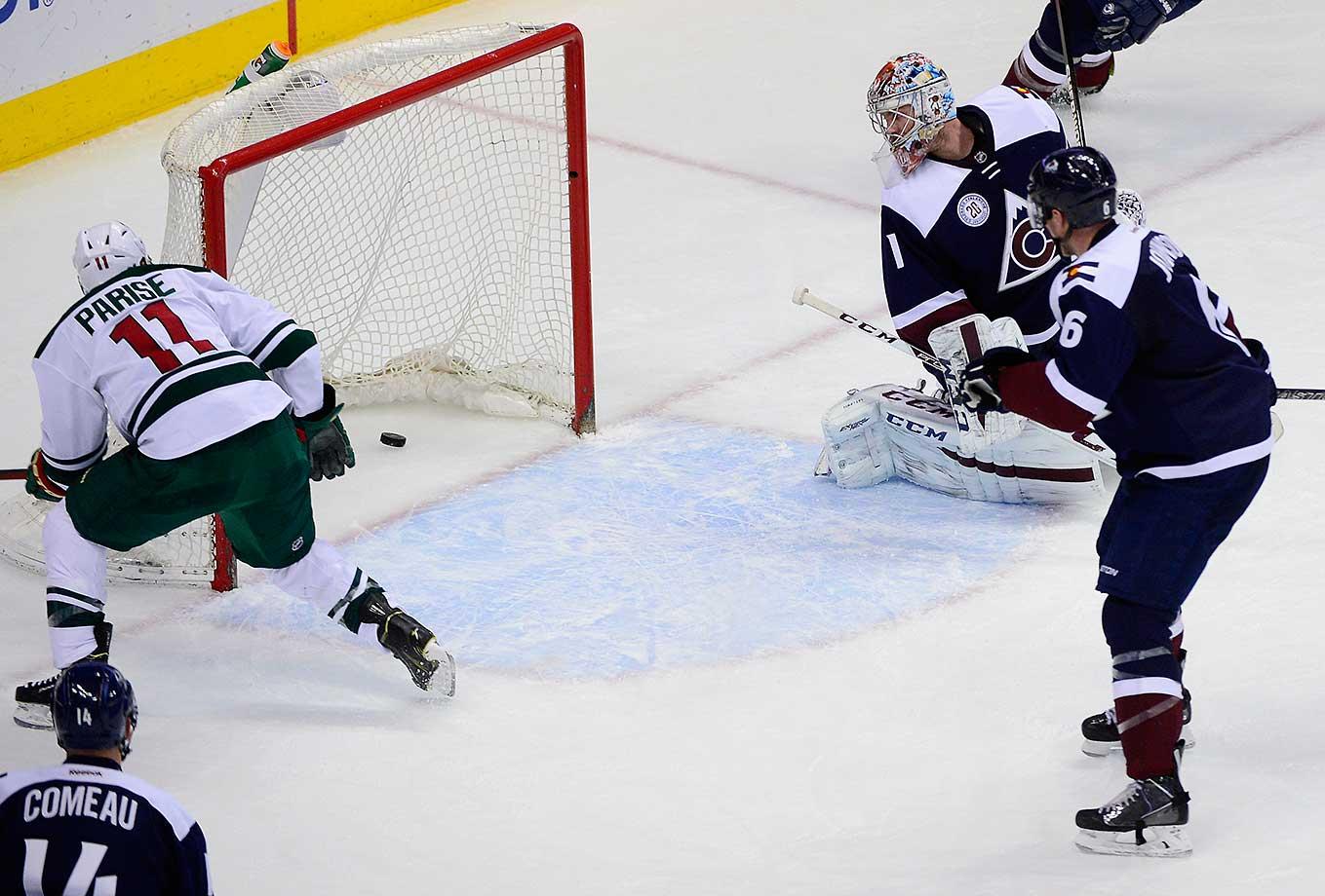 Colorado goalie Semyon Varlamov looks back after Minnesota's Zach Parise scores.