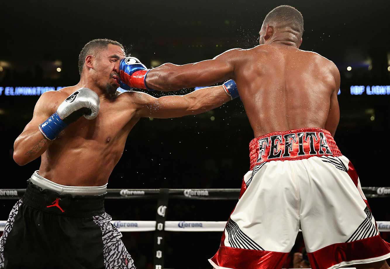 Andre Ward takes a punch against Sullivan Barrera in their IBF Light Heavyweight bout in Oakland.