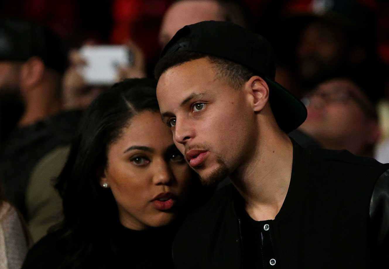 Stephen Curry and his wife Ayesha at the Andre Ward-Sullivan Barrera bout at ORACLE Arena in Oakland.