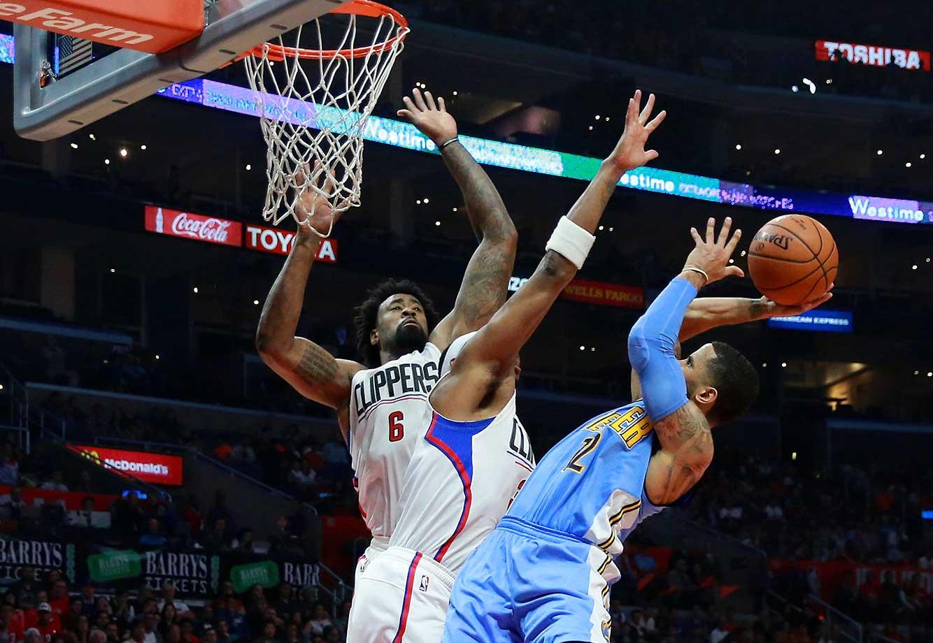 DeAndre Jordan (6) and teammate Paul Pierce defend a shot by D.J. Augustin of the Denver Nuggets.