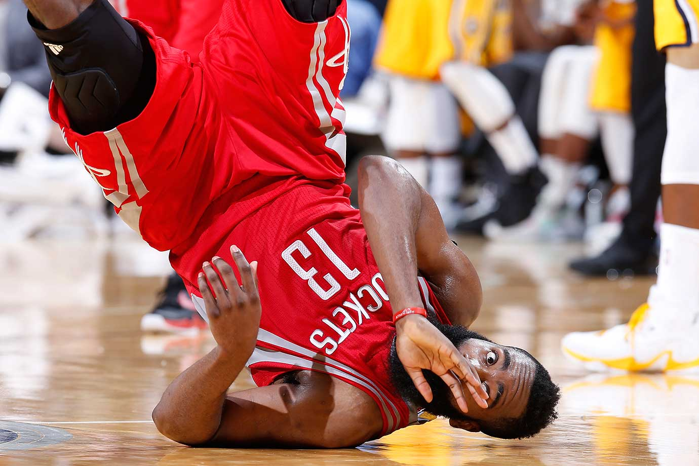 James Harden of the Houston Rockets falls over after drawing a foul against the Indiana Pacers.