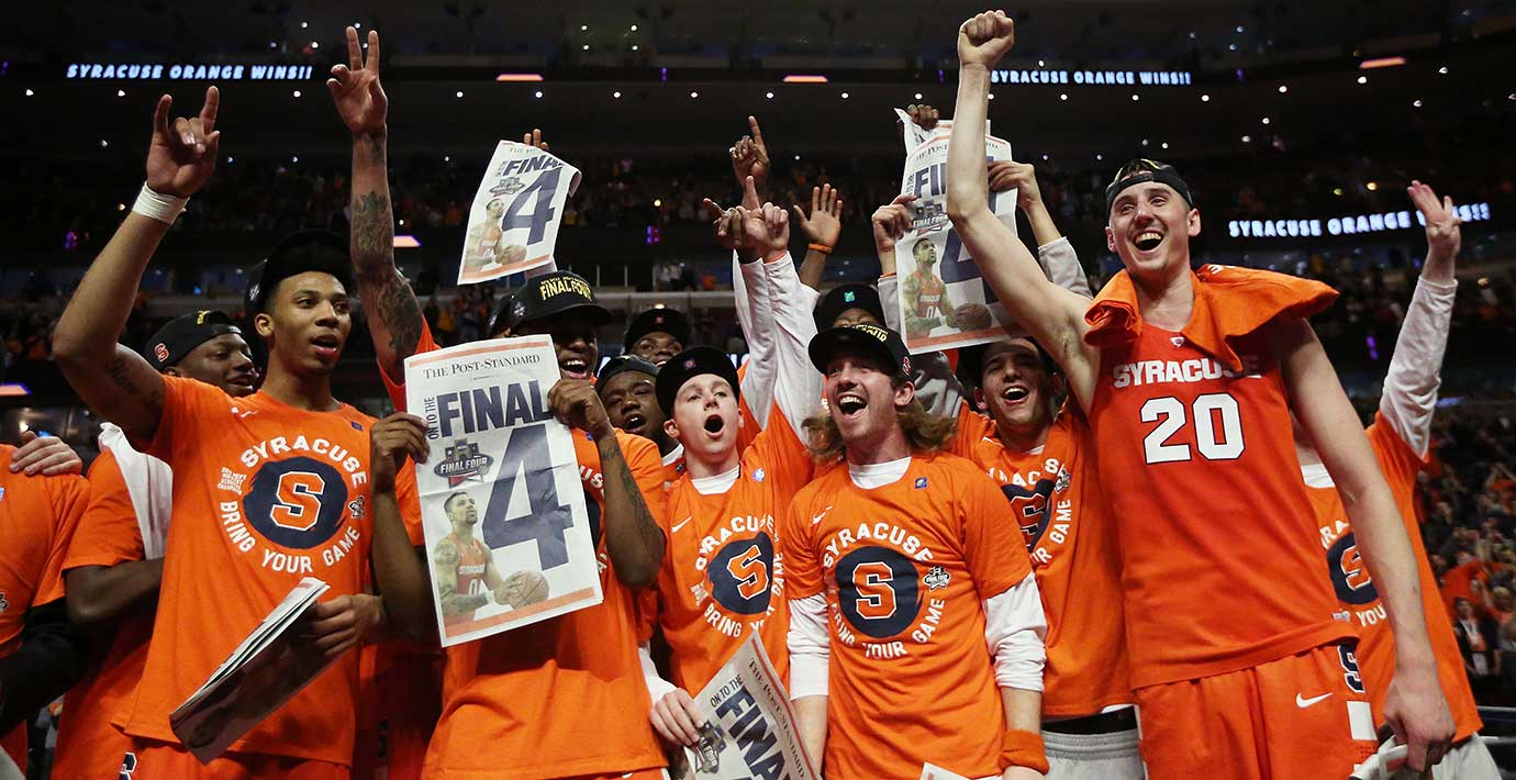 The Syracuse Orange celebrate their 68-62 win and berth in the Final Four with special edition newspapers.