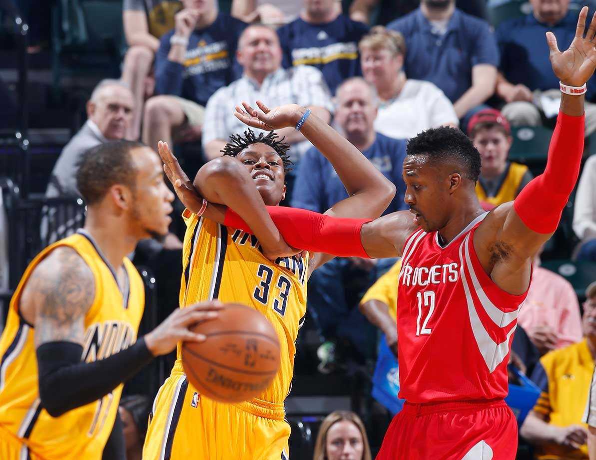 Myles Turner of the Indiana Pacers fights for position against Dwight Howard of the Houston Rockets.