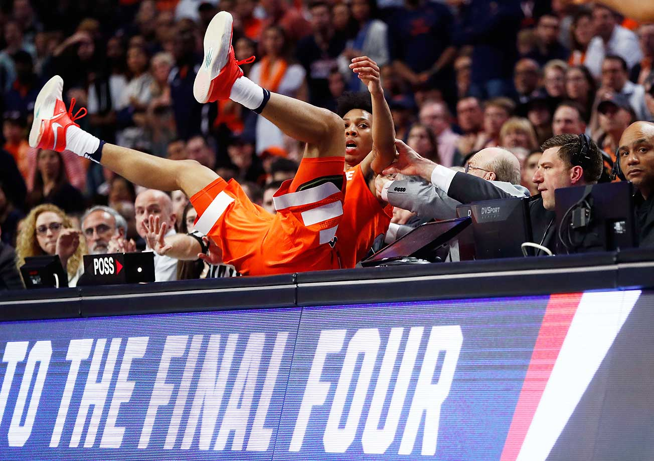 Malachi Richardson of Syracuse falls off of the court in the second half against the Virginia Cavaliers.