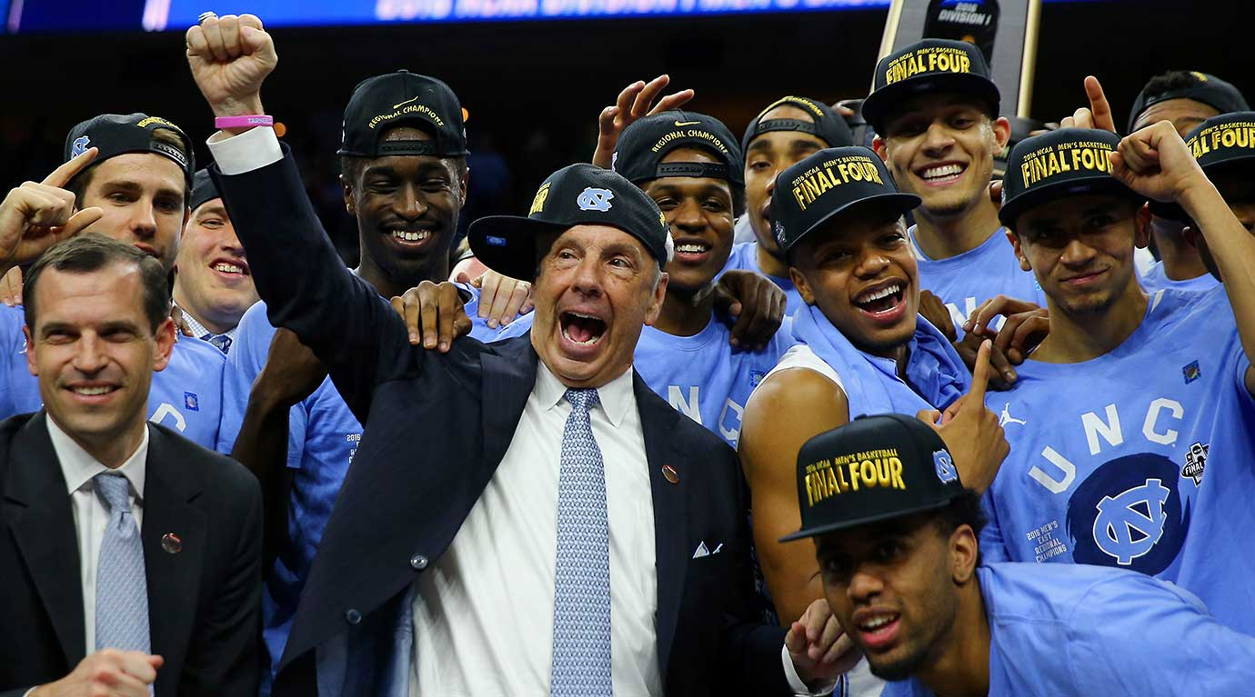 Head coach Roy Williams with his team after defeating the Notre Dame Fighting Irish.