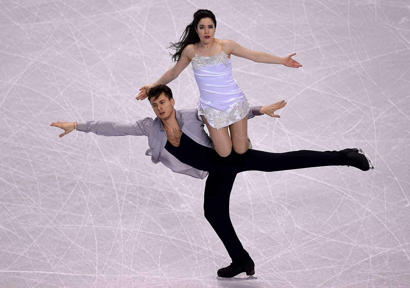 Celia Robledo and Luis Fenero from Spain at the Ice Dance practice session for the World Figure Skating Championships in Boston.