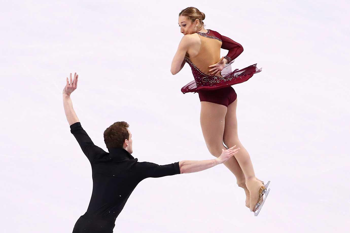 Lola Esbrat and Andrei Novoselov of France skate in the Pairs Short Program.