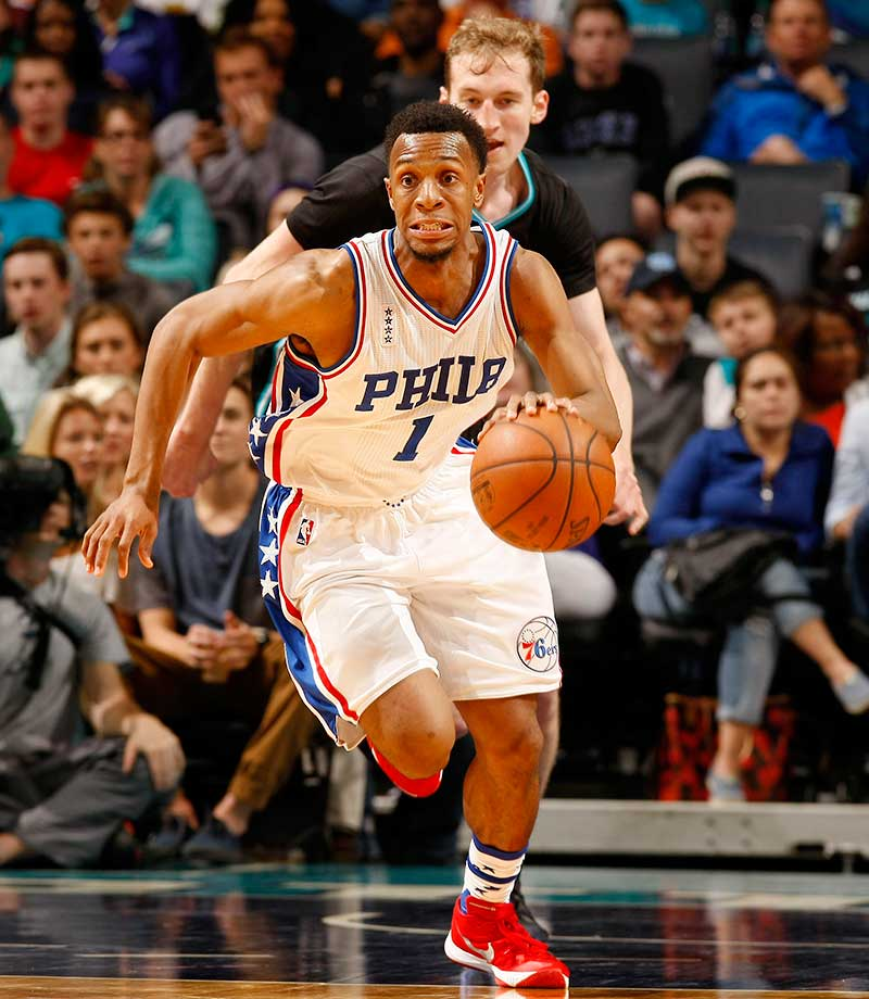 Ish Smith of the Philadelphia 76ers drives against the Charlotte Hornets.