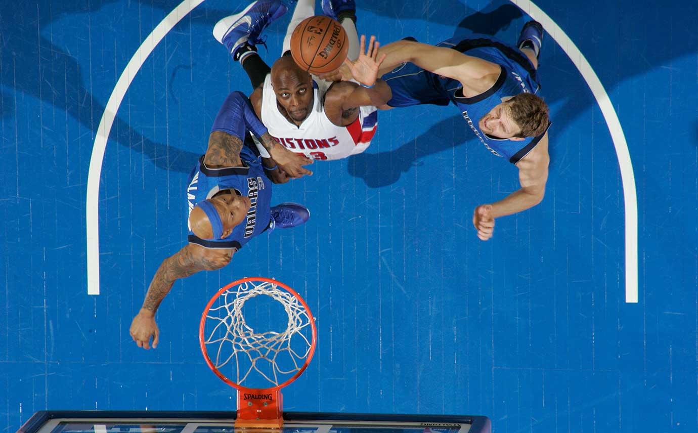 Ersan Ilyasova of the Detroit Pistons goes to the basket against the Dallas Mavericks.
