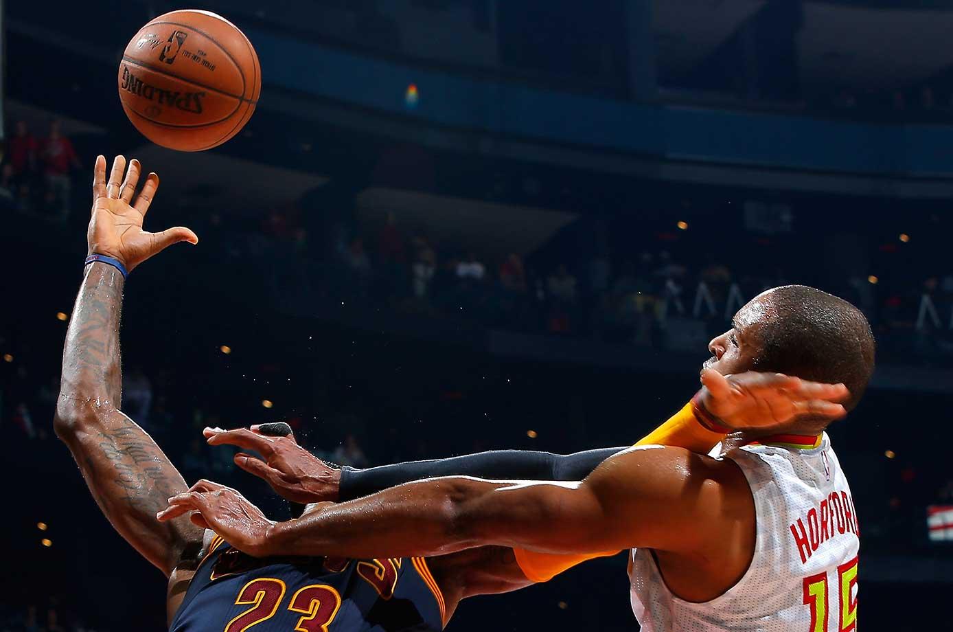 Al Horford of the Atlanta Hawks seemingly makes LeBron James lose his head on a hard foul.