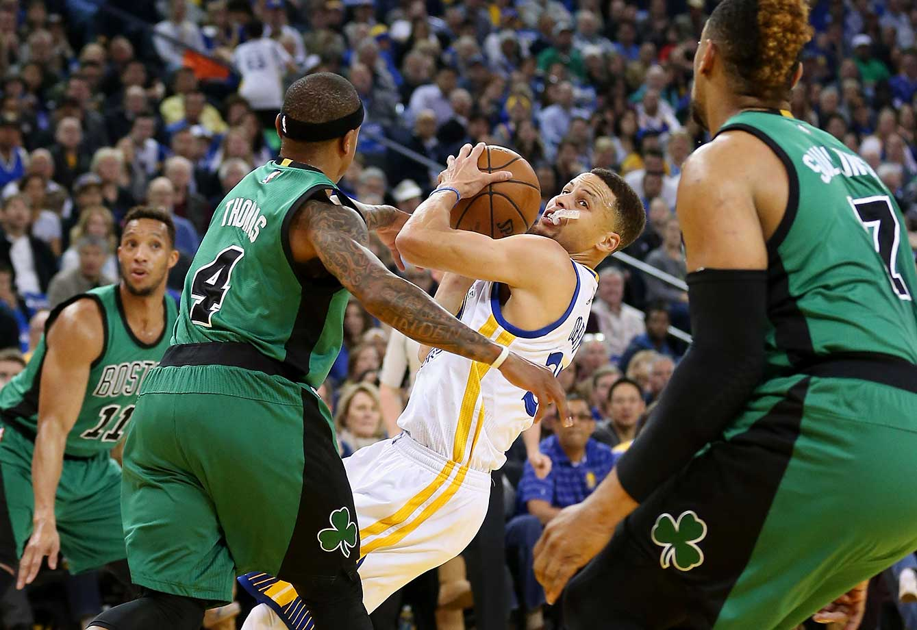 Here are some of the images that caught our eye on a night when the Boston Celtics snapped the Golden State Warriors' 54-game regular-season home winning streak. Steph Curry and the Warriors made 22 turnovers in the game.
