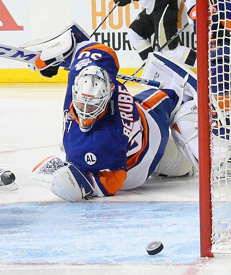 Jean-Francois Berube of the New York Islanders watches a shot just miss the net in a game against Pittsburgh.