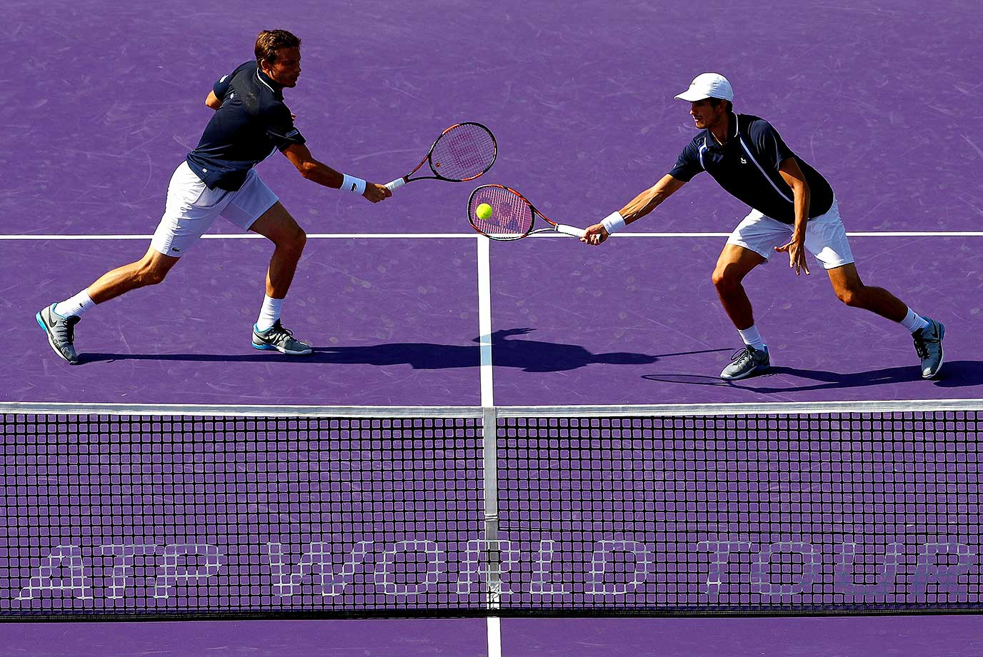 Pierre-Hugues Herbert and Nicolas Mahut of France play in the doubles final against of the Miami Open.