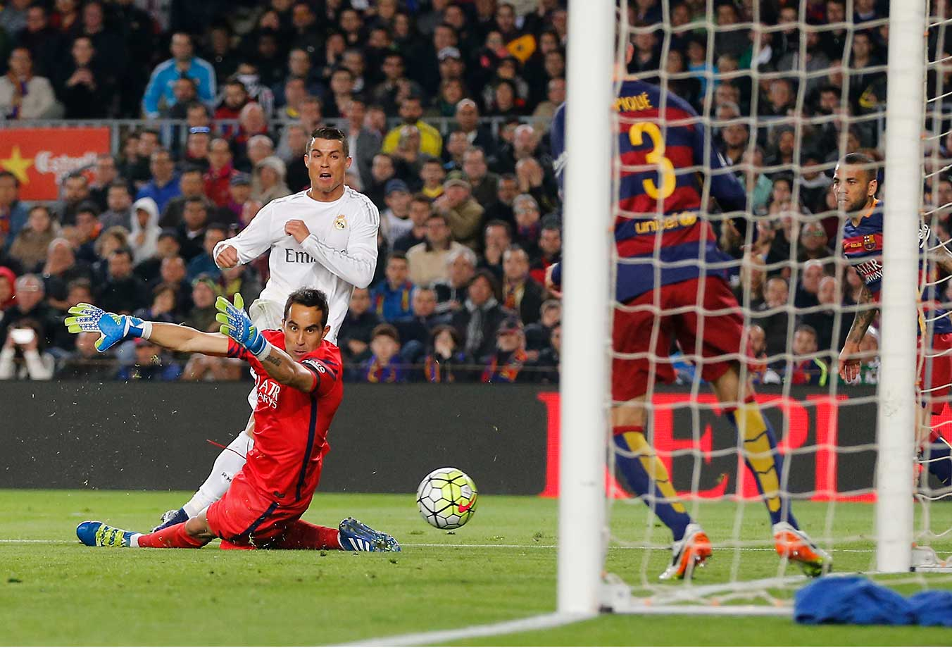 Cristiano Ronaldo of Real Madrid scores the winning goal during the La Liga match between FC Barcelona and Real Madrid CF at Camp Nou.
