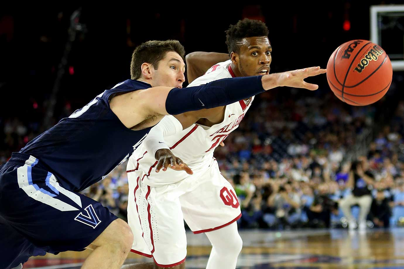 Ryan Arcidiacono of Villanova deflects the ball before it can reach Buddy Hield of Oklahoma.